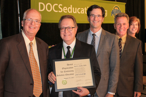 Karl A. Smith, DDS, FDOCS, is recognized by members of the DOCS Education faculty for the attainment of his distinguished Fellow certification.